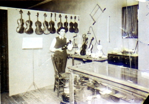 Rare photo of Julian Lapinski in his shop with his violins, circa 1922